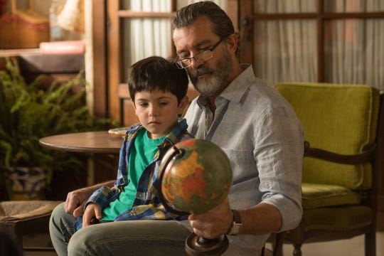 """Mr. Saccione (Antonio Banderas) gifts young Rodrigo (Adrian Marrero) with a globe in """"Life Itself."""""""
