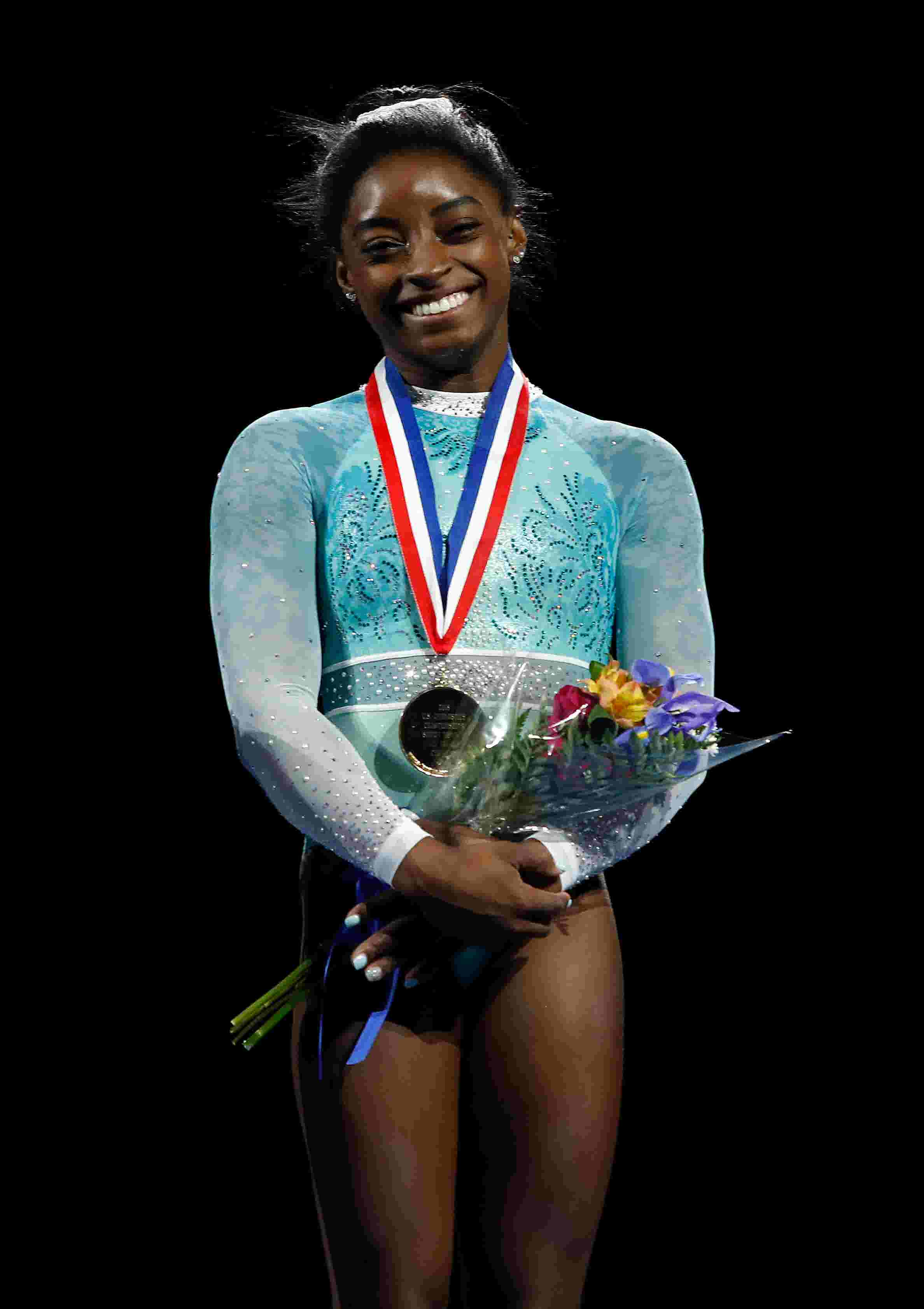 8e8af37c0 Olympic champion Simone Biles using her power in a new way