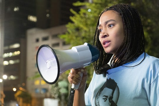 "Starr Carter (Amandla Stenberg) becomes an activist for change after a childhood friend is gunned down in front of her in the drama ""The Hate U Give."""
