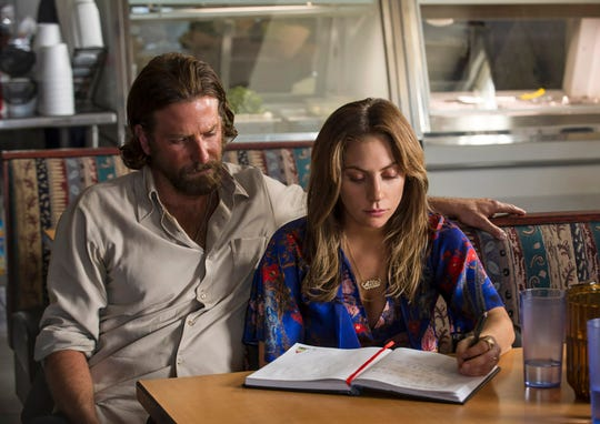 """Hard-living singer Jackson Maine (Bradley Cooper) takes young up-and-comer Ally (Lady Gaga) under his wing in """"A Star Is Born"""" (Oct. 5)."""