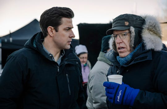 "John Krasinski (left) goes over a scene with executive producer Carlton Cuse on the set of Amazon's ""Jack Ryan."""