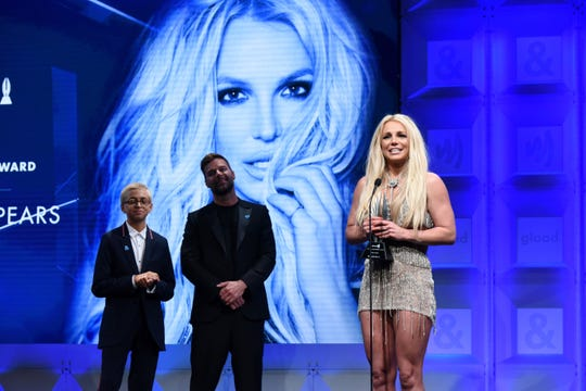 Totah, left, has announced she is a transgender female who now goes by Josie. In this April 12, 2018 photo, she stands with Ricky Martin as Britney Spears accepts the GLAAD Media Awards Vanguard Award.