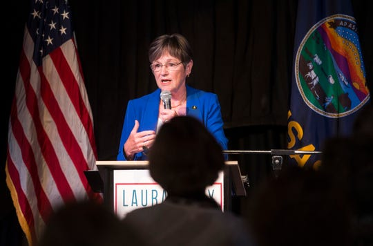 FILE- In this Aug. 7, 2018, file photo Democratic candidate for Kansas governor Laura Kelly speaks to supporters at a watch party, in Topeka, Kan., after she won her party's nomination for governor during a primary election.