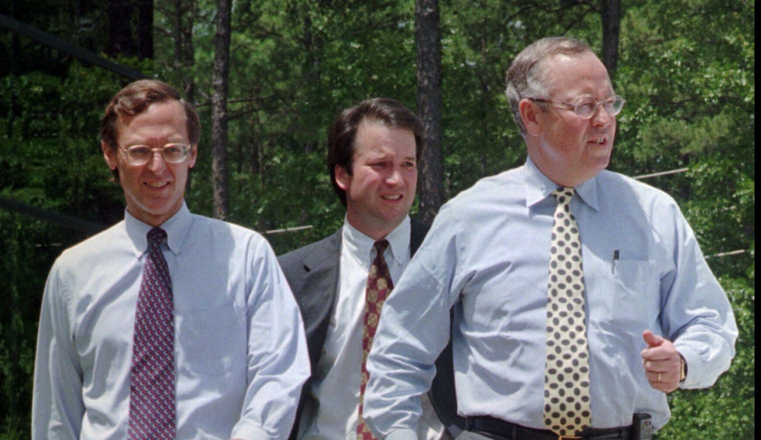 Current Supreme Court nominee Brett Kavanaugh, center, walks alongside independent counsel Ken Starr in 1997 during their investigation of President Bill Clinton.