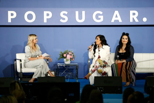 "Kirbie Johnson, Huda Katton and Mona Kattan speak onstage during the ""Beauty's Biggest Sister Act"" panel on day 2 of POPSUGAR Play/Ground on June 10, 2018, in New York City."