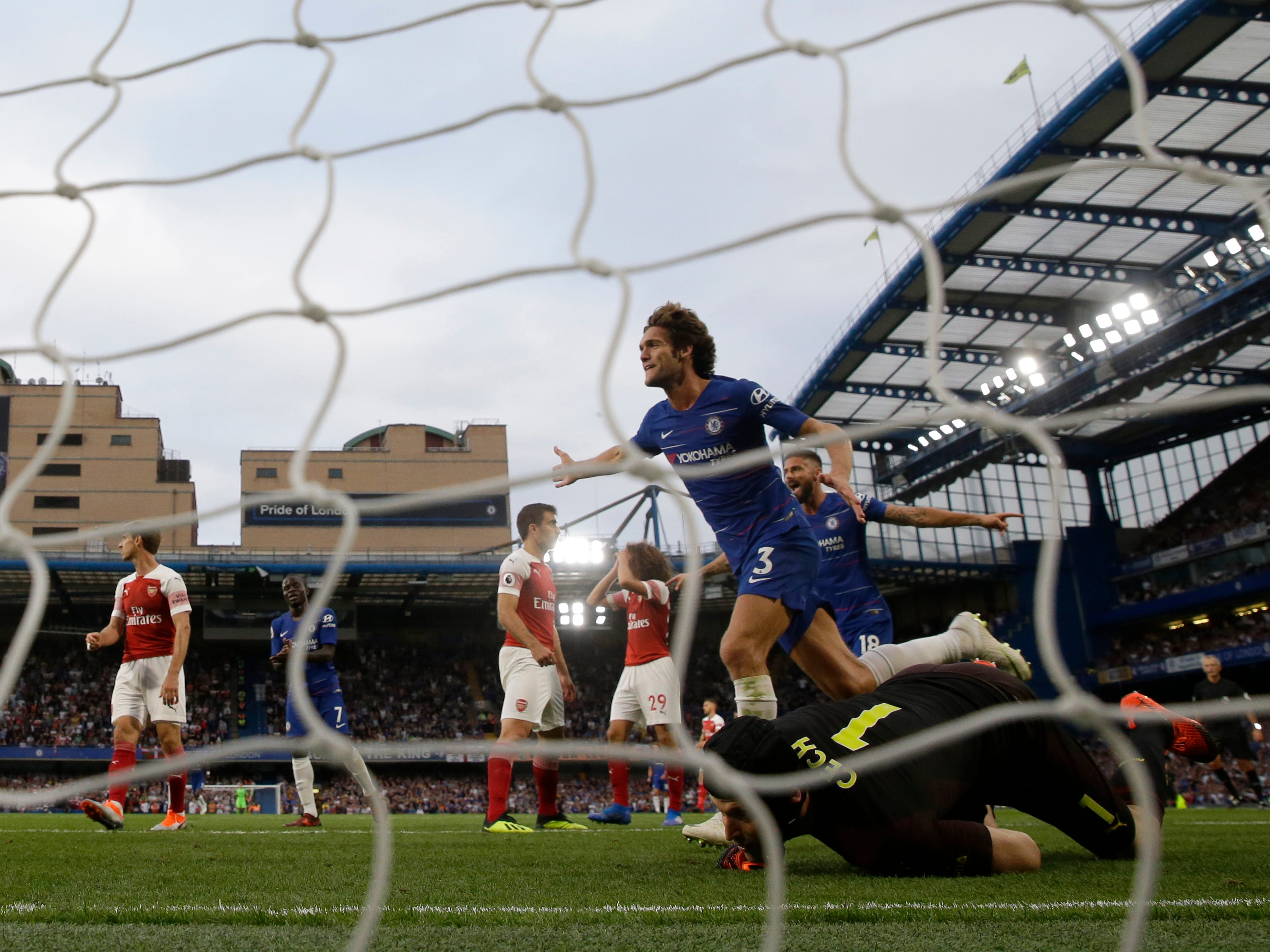 Chelsea's Marcos Alonso celebrates after scoring the go-ahead goal in a 3-2 win over Arsenal at Stamford Bridge.