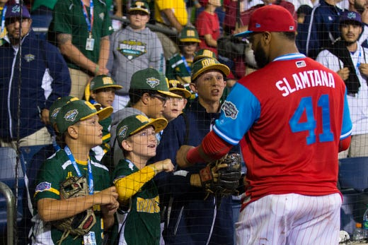 96b87f009 Philadelphia Phillies first baseman Carlos Santana (41) meets with Little  Leaguers after the game