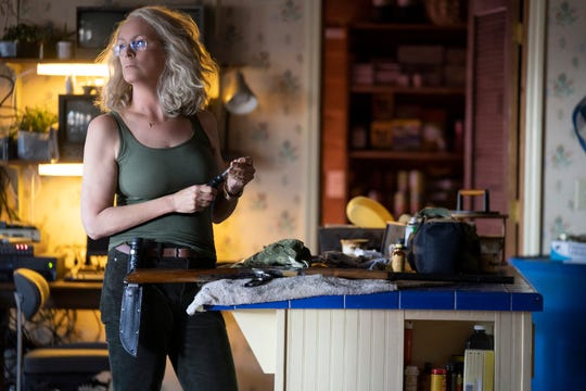 "Laurie Strode (Jamie Lee Curtis) gets all her weaponry in order as she waits for the return of masked psycho Michael Myers in ""Halloween"" (Oct. 19)."