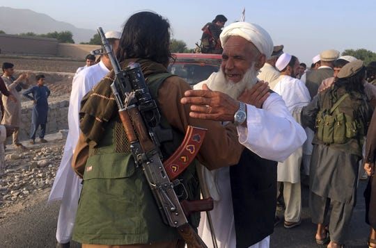 Taliban fighters gather with residents to celebrate a three-day cease-fire marking the Islamic holiday of Eid al-Fitr on June 16, 2018, in Nangarhar province, east of Kabul, Afghanistan.