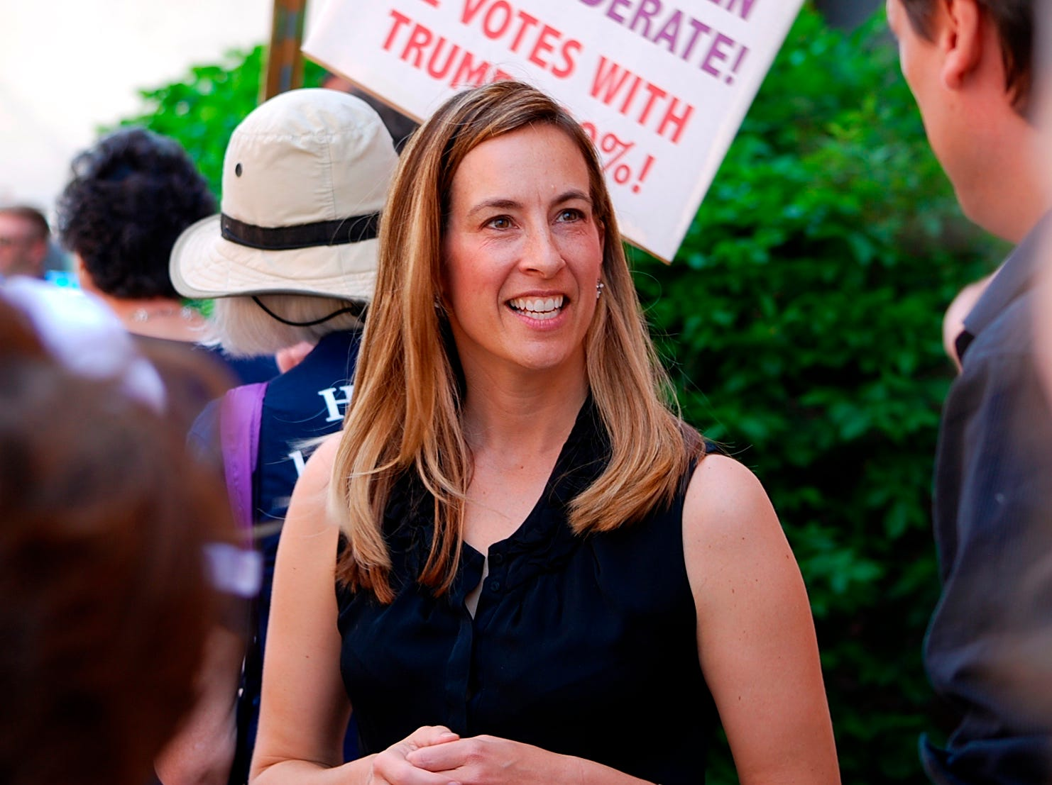 FILE- In this May 19, 2017, file photo, Mikie Sherrill joins protesters with NJ 11th for Change outside of U.S. Rep. Rodney Frelinghuysen's Morristown office.