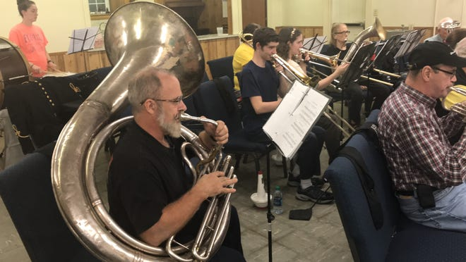 A 93-year-old helicon serves as the bass horn for the Greenville Textile Heritage Band.