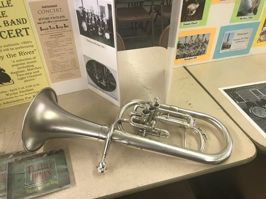 An alto horn, a type of instrument no longer used in modern brass bands, played by Dan Steadman of the Greenville Textile Heritage Band.