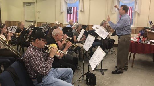 Wayne Bagwell directs the Greenville Textile Heritage Band as it practices for Saturday's concert.
