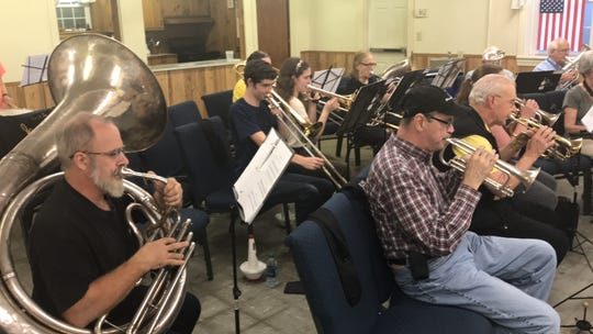 The Greenville Textile Heritage Band practices for Saturday's concert.
