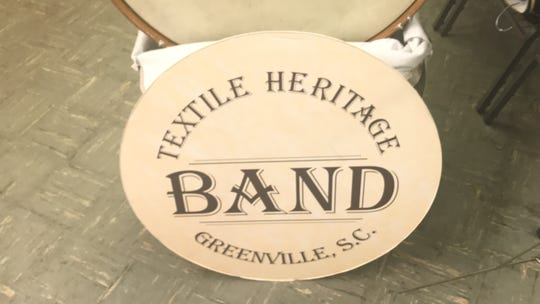 Bass drum logo of the Greenville Textile Heritage Band