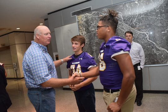 Tom Zabasky (left) talks with Alexandria Senior High School football players Jack Granger (center) and Aaron Ealy (right) at the City of Alexandria Rotary Club's Pigskin Preview held Tuesday. Along with ASH, football coaches and players from Bolton High School, Buckeye High School, Northwood High School, Peabody Magnet High School, Pineville High School and Tioga High School as well as Louisiana College were at the Rotary luncheon to tell Rotarians about their programs and expectations for the upcoming season.