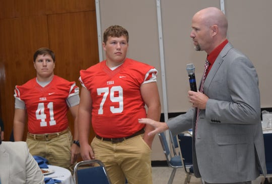 Tioga High School football coach Kevin Cook (far right) introduces two members of the Tioga team, Michael Shamblin (left) and Dalton Scroggs (center) at the City of Alexandria Rotary Club's Pigskin Preview held Tuesday. Football coaches and players from Alexandria Senior High School, Bolton High School, Buckeye High School, Northwood High School, Peabody Magnet High School, Pineville High School and Tioga High School were at the Rotary luncheon to tell Rotarians about their programs and expectations for the upcoming season.