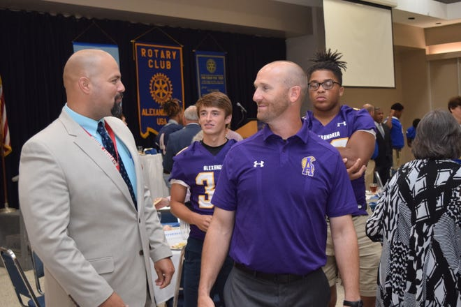 Tioga High School principal Alan LaCombe (left) talk with Alexandria Senior High School football coach Thomas Bachman at the City of Alexandria Rotary Club's Pigskin Preview held Tuesday at the Rotary luncheon. With Bachman are players Jack Granger (center left, back) and Aaron Ealy (back right). Along with ASH, football coaches and players from Bolton High School, Buckeye High School, Northwood High School, Peabody Magnet High School, Pineville High School and Tioga High School as well as Louisiana College were at the Rotary luncheon to tell Rotarians about their programs and expectations for the upcoming season.
