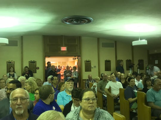 The crowd spilled out of the municipal courtroom during a Middletown Township Committee meeting in August in which Village 35, a controversial retail development, was a topic of discussion.