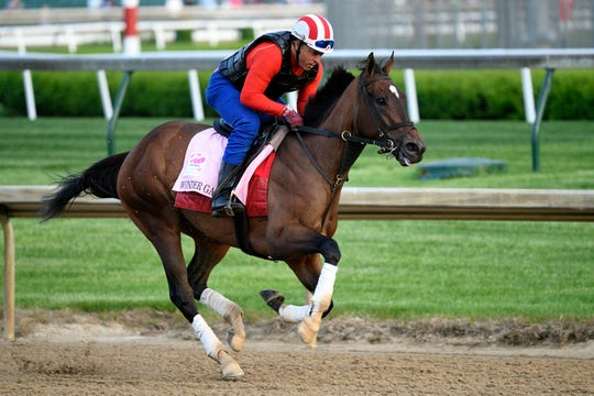 Exercise rider Orlando Cross works out Kentucky Oaks entry Wonder Gadot at Churchill Downs.