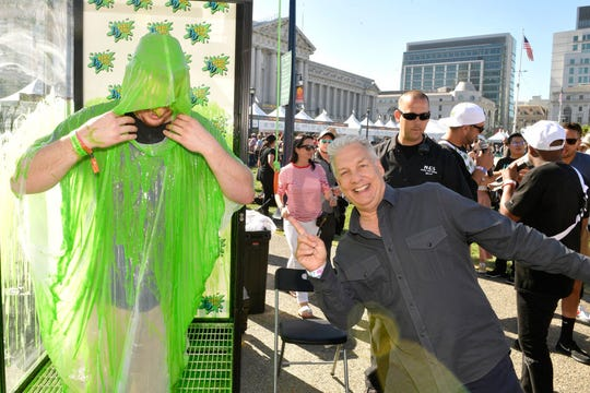 A festivalgoer and Marc Summers attend Double Dare presented by Mtn Dew Kickstart at Comedy Central presents Clusterfest on June 2, 2018 in San Francisco, California.
