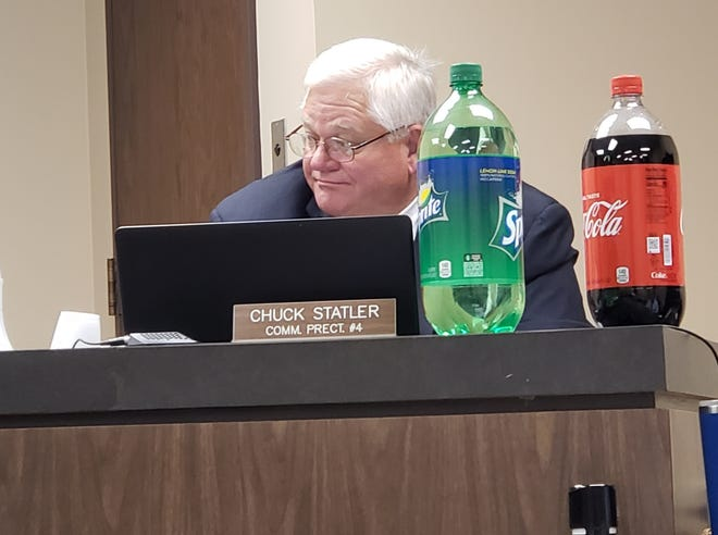 Taylor County Commissioner Chuck Statler uses soda on Tuesday to explain how much an average home's taxes will go up with the proposed 2019 county budget.