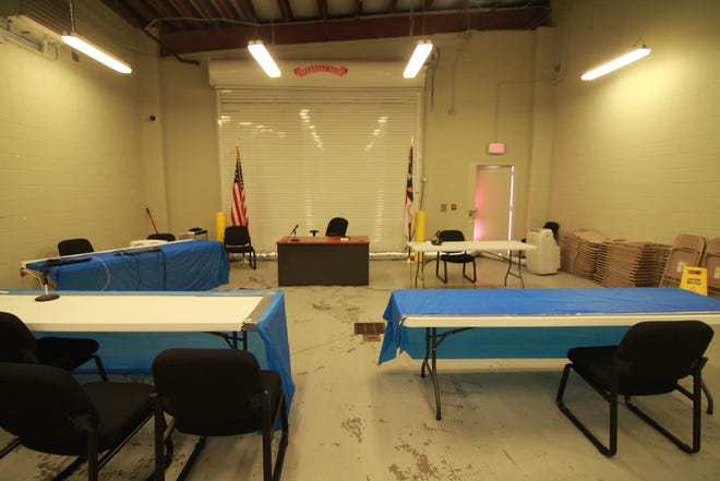 Madison County Sheriff's Office deputies arranged a makeshift courtroom in a garage beside the jail to hold district court cases at the start of July.