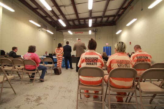 Inmates await their hearings inside a Madison County Jail sally port.