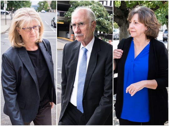 Buncombe County's former top officials arrive to the federal courthouse in downtown Asheville, where they pleaded not guilty to charges tied to a contractor bribery scheme alleged by prosecutors.