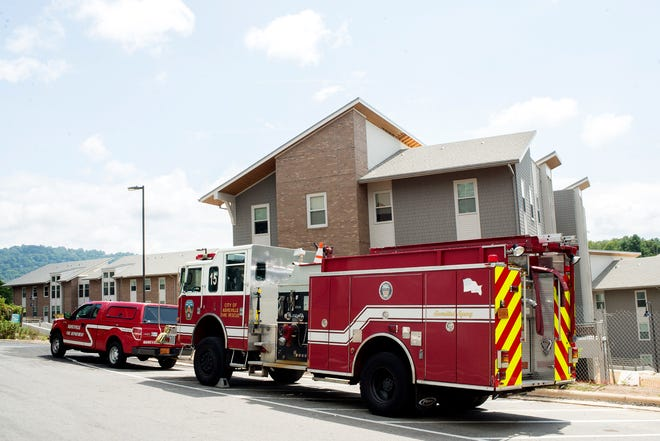A fire engine sits outside of Aspen Hall, one of five apartment buildings that make up The Woods at UNCA.