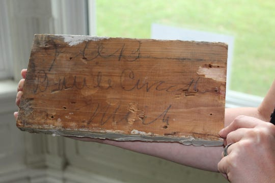 "This baseboard accent piece was found at the 1870s-built home at 26 Fremont Street. It says ""JCB Battle Creek, Mich.,"" to note who it was for, John Carlos Barber from Battle Creek."
