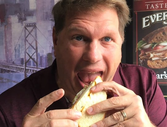 The Enquirer's Bill Broderick tries The Kramer at Sidestreets Deli in Charlotte during another stop on the Bill's Bites Goes To The Edge Tour