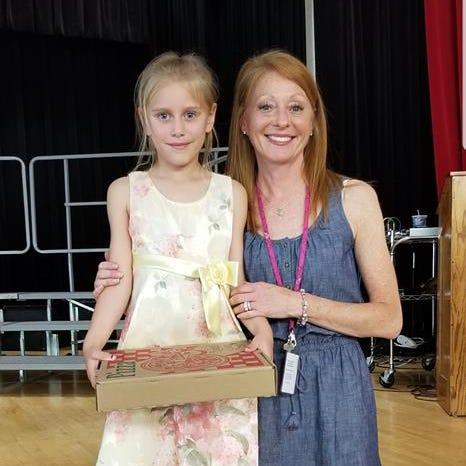 Miya Shedd, 6, poses alongside her Kindergarten teacher Cassandra Cline at George F Johnson Elementary School. Miya had Cline as a kindergarten teacher during the 2017-2018 school year.