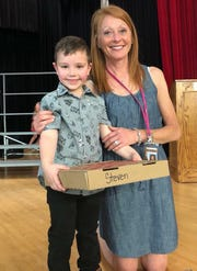 Michelle Martone Gillette's son, Steven, poses alongside Cassandra Cline in June.