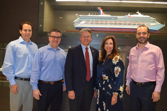 Executives from Carnival Cruise Line and the Port Canaveral are shown at the cruise line's Miami headquarters following a meeting to discuss the deployment of a new 180,000-ton ship, Carnival's largest, to Port Canaveral.  From left are  Carnival Corp. Vice President for Port and Destination Development David Candib, Carnival Cruise Line Executive Vice President for  Professional Services James Heaney, Canaveral Port Authority Chief Executive Officer  John Murray, Carnival Cruise Line President Christine Duffy and Carnival Cruise Line COO Gus Antorcha.