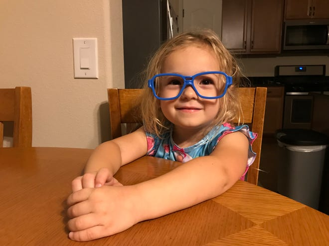 "Isabella wears a set of ""goggles"" to look like the minions from the movie ""Despicable Me."""