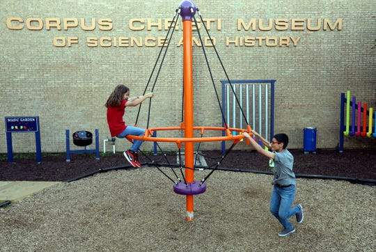 Anthony Gongora (right) and Denise Gongora play outside during the grand opening of the HEB Science Center on Friday, April 1, 2016, at the Corpus Christi Museum of Science and History in Corpus Christi.