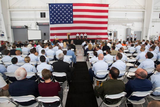 Members of the Coast Guard and officials gather during the Hurricane Harvey awards ceremony on Tuesday, August 21, 2018 at Valent Hall.