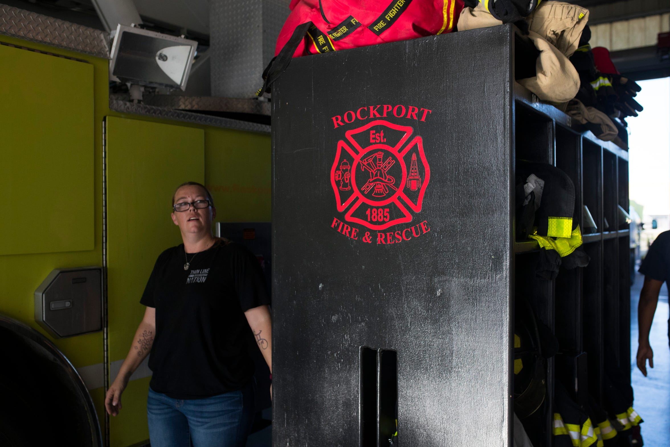 Emily Guerrero walks through the Rockport Volunteer Fire Department station during their monthly meeting on Thursday, August, 16, 2018 in Rockport. Twenty  two members of their department stayed in their station during Hurricane Harvey.