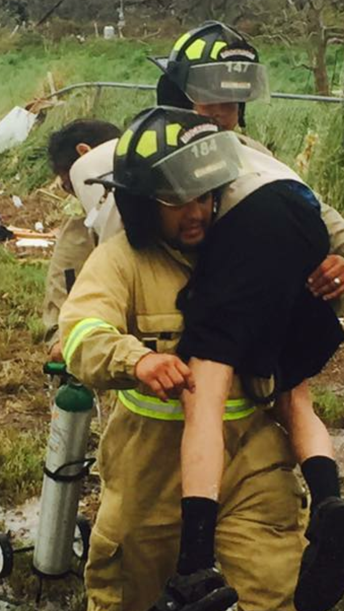 Aaron Guerrero, a Rockport volunteer firefighter, lifts a man after Hurricane Harvey hit Aransas County on Aug. 25, 2017.