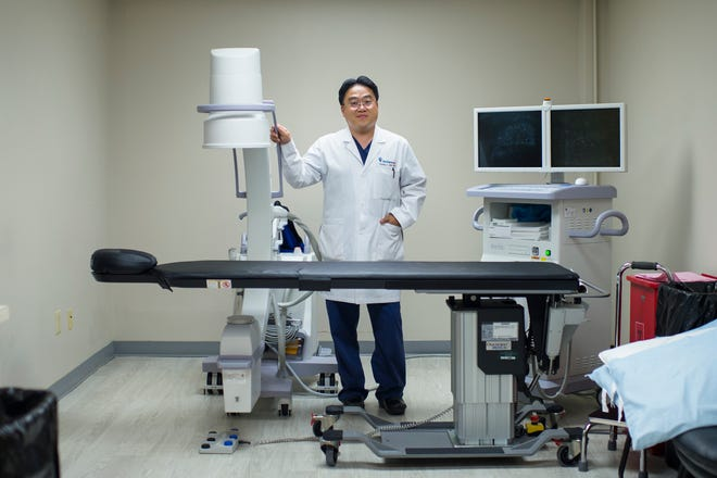 Pain specialist Dr. Young J. Lee poses inside a Relievus clinic in Cherry Hill, where patients are treated for chronic pain. Besides traditional pain remedies, the practice offers alternatives to opioid painkillers, including ketamine infusions, medical marijuana and stem cell therapy.