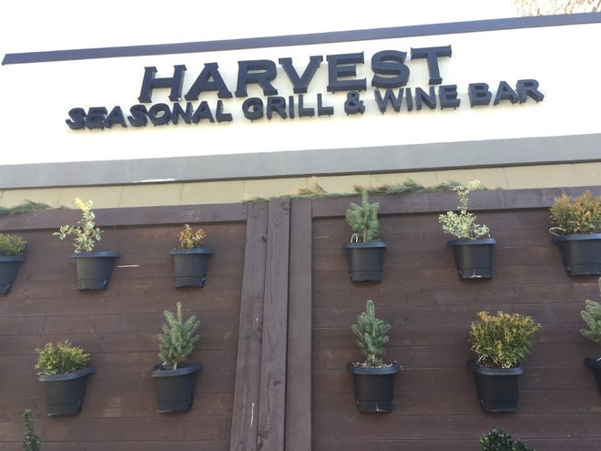 Harvest Seasonal Grill & Wine Bar at Moorestown Mall has settled a class-action lawsuit brought by servers and bartenders.
