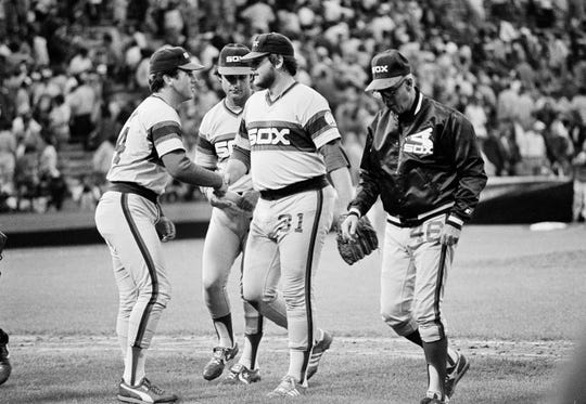 Chicago White Sox' LaMarr Hoyt, is congratulated by Richard Dotson, left, and manager Tony LaRussa after he beat the Baltimore Orioles 2-1 Wednesday, Oct. 6, 1983 in Baltimore.