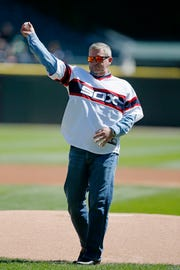 Former Chicago White Sox player Richard Dotson throws out a ceremonial first pitch before a baseball game between the Minnesota Twins and the Chicago White Sox on Sunday, Sept. 14, 2014, in Chicago. The Minnesota Twins won 6-4. (AP Photo/Andrew A. Nelles)