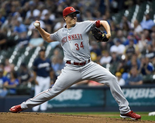 Cincinnati Reds pitcher Homer Bailey (34) throws a pitch in the first inning against the Milwaukee Brewers at Miller Park.