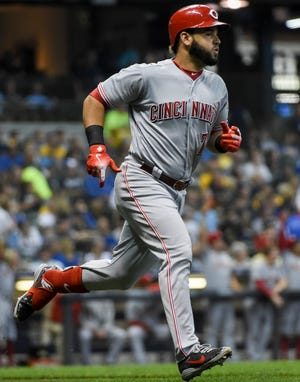 Cincinnati Reds third baseman Eugenio Suarez (7) runs the bases after hitting a solo home run in the second inning against the Milwaukee Brewers at Miller Park.