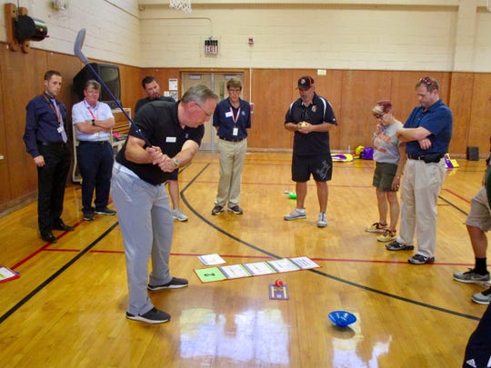 Michael Blackwell, Northeast regional director for The First Tee, walking Linden physical education teachers through The First Tee activities and curriculum guide.