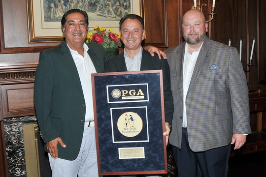 Holding his plaque, Mike Setola, president and CEO of Tharanco Lifestyles,is flanked by (left) Haresh Tharani, Chairman & CEO Tharanco Group and2011 Chairman's Award Recipient and (right) Chris Hunt, Executive Director of the NJGF.