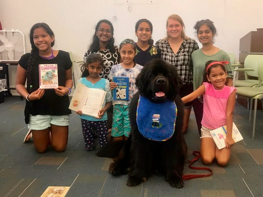 On Thursday, Aug. 9, Bridgewater-Raritan High School sophomore study buddies held a summer review for children entering grades 1 to 4 at Somerset County Library System of New Jersey (SCLSNJ)'s Somerville Library branch. Tank, a therapy dog, stopped by to listen to the children read. Explore more events at your library: sclsnj.libnet.info/events. Pictured are Bridgewater-Raritan High School sophomores (back row from left to right) Nandinii Sekar, Nikitha Shivakumar, Nicole Sydor; and Tanisha Nashine and (front row from left to right) Cielo Morales, 11, of Somerville, Rose Ria Putti, 6, of Somerville, Ashraya Tripetee, 9, of Somerville, and Brianna Morales, 7, of Somerville with Tank.