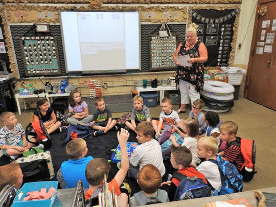 Kindergarten teacher Michelle Beitzel does roll call for the first day of school Tuesday at Conesville Elementary. She's been at the school 16 years.